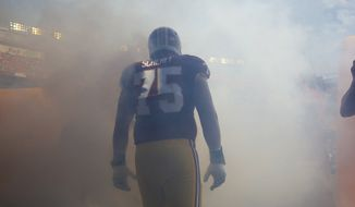 Washington Redskins offensive tackle Brandon Scherff (75) prepares to enter the field before an NFL football game against the Miami Dolphins, Sunday, Sept. 13, 2015, in Landover, Md. (AP Photo/Patrick Semansky)