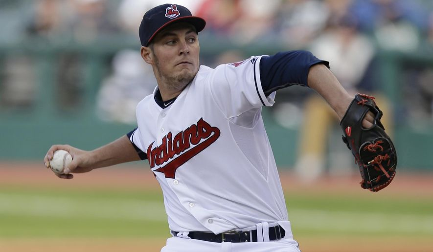 Cleveland Indians starting pitcher Trevor Bauer delivers in the first inning of the second game of a baseball doubleheader against the Detroit Tigers, Sunday, Sept. 13, 2015, in Cleveland. (AP Photo/Tony Dejak)