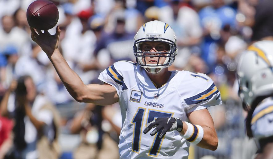 San Diego Chargers quarterback Philip Rivers throws a pass against the Detroit Lions during the first half of an NFL football game, Sunday, Sept. 13, 2015, in San Diego. (AP Photo/Denis Poroy)