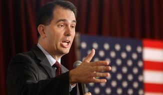 """""""Today I believe that I am being called to lead by helping to clear the field in this race so that a positive conservative message can rise to the top of the field,"""" said Wisconsin Gov. Scott Walker. """"With this in mind, I will suspend my campaign immediately."""" (Associated Press)"""