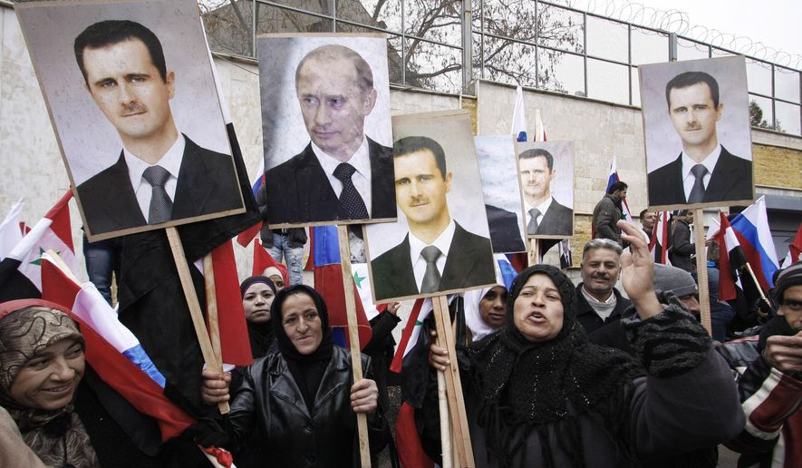 In this Sunday, March 4, 2012, file photo, Syrians hold posters of Syrian President Bashar Assad, far left, and Russian President Vladimir Putin, second left, during a pro-Syrian govermment protest in front of the Russian Embassy in Damascus, Syria. (AP Photo/Muzaffar Salman, File)