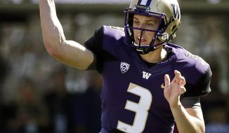 FILE - In this Sept. 12, 2015, file photo, Washington quarterback Jake Browning throws against Sacramento State in the first half of an NCAA college football game in Seattle.  It was clear freshman quarterback Jake Browning was going to have an impact for Washington. He's not the only youngster showing up for the Huskies. Their leading rusher after two weeks is also a freshman, Myles Gaskin. (AP Photo/Elaine Thompson, File)