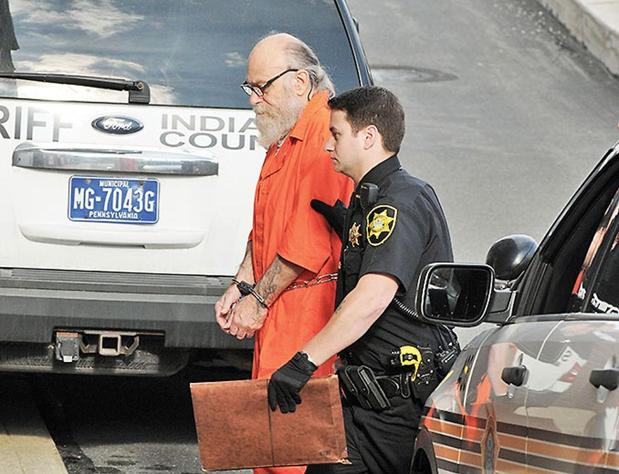 FILE - In this Aug. 13, 2015 file photo, Lewis Fogle, left, is escorted to the back door of the Indiana County Courthouse by Deputy Dave Angelo in Indiana, Pa. The Indiana County district attorney is scheduled to announce on Monday, Sept. 14, 2015 whether he'll retry Fogle for second-degree murder in the rape and shooting death of a 15-year-old girl in 1976. Fogle, who spent 34 years in prison for the crime, had a judge vacate his murder conviction, citing new DNA evidence. (Tom Peel/The Indiana Gazette via AP, File)