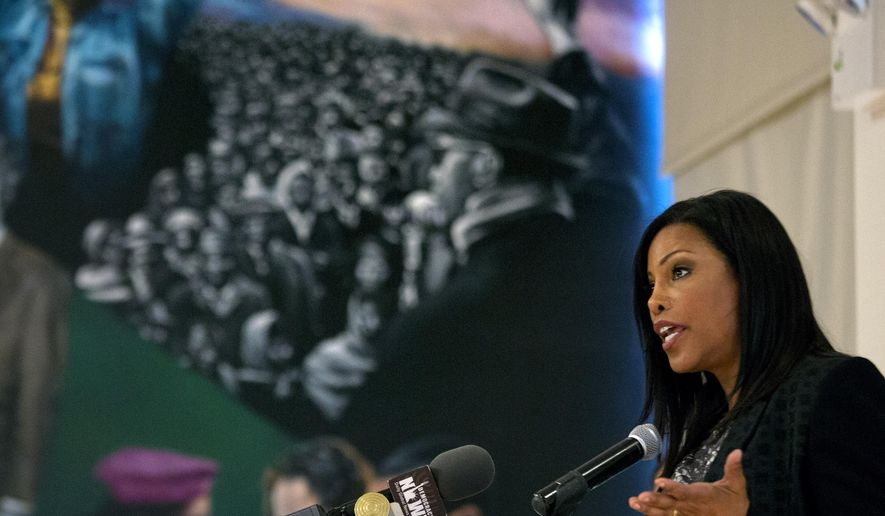 FILE - In this Saturday, Feb. 21, 2015, file photo, Ilyasah Shabazz, daughter of Malcolm X, speaks about her father and family with a mural depicting their lives behind her, as family, activists, actors, and politicians remembered the civil rights leader during a ceremony at the New York site in Harlem where he was killed 50 years earlier to the day. Shabazz and prize-winning authors Gary Paulsen and M.T. Anderson are among the 10 nominees on the National Book Awards' long list for young people's literature, the National Book Foundation announced, Monday, Sept. 14, 2015. (AP Photo/Craig Ruttle, File)