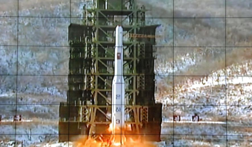 In this Dec. 12, 2012, file photo, a screen at the General Satellite Control and Command Center shows the moment North Korea's Unha-3 rocket is launched in Pyongyang, North Korea. North Korea said Monday, Sept. 14, 2015, it is ready to launch satellites aboard long-range rockets to mark a key national anniversary next month, a move expected to rekindle animosities with its rivals South Korea and the United States. (AP Photo/File)