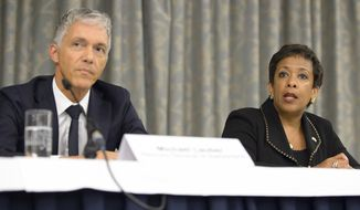 Michael Lauber (left), attorney general of Switzerland, and U.S. Attorney General Loretta Lynch arrive for the a news conference on soccer related criminal proceedings, in Zurich, Switzerland, on Sept. 14, 2015. Lynch says she expects more indictments in a widening investigation of corruption implicating FIFA. (Anthony Anex/Keystone via Associated Press)