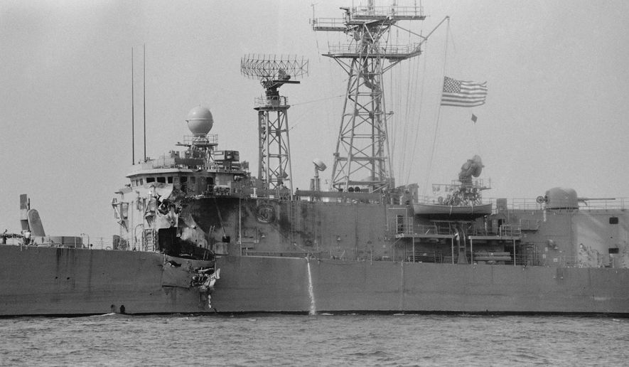 The USS Stark, its flag at half mast, limps toward Bahrain Tuesday, May 19, 1987, with a gaping and jagged hole in the hull below her bridge. Thirty-seven sailers were killed when a French-made Exocet missile exploded on the Stark after being fired at by an Iraq jet fighter Sunday night. (AP Photo/Zouhair Saade)