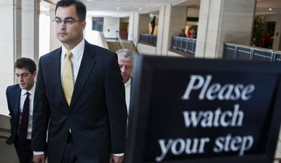 Bryan Pagliano, a former State Department employee who helped set up and maintain a private email server used by Hillary Rodham Clinton, departs Capitol Hill in Washington on Sept. 10, 2015, to give his deposition to a House panel on the Benghazi investigation. Pagliano will assert his constitutional right not to testify before any congressional committees, his lawyer says. (Associated Press) **FILE**