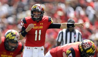 Maryland quarterback Perry Hills points across the line of scrimmage in the first half of an NCAA college football game against Richmond, Saturday, Sept. 5, 2015, in College Park, Md. (AP Photo/Patrick Semansky)