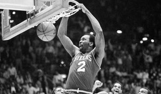 Philadelphia 76ers' Moses Malone slams home two of his 24 points in a playoff game against the Lakers, in Los Angeles, Calif., on June 1, 1983. The Sixers went on to sweep the Lakers four games straight to win the NBA championship. (AP Photo)