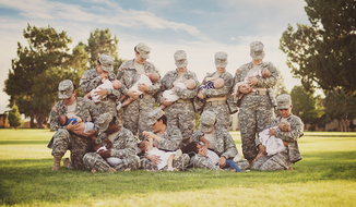 In a photo that has gone viral, a group of female soldiers at Fort Bliss nursed their babies in full uniform as an effort to normalize breastfeeding in the military. (Facebook/Tara Ruby Photography)