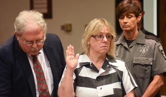 Joyce Mitchell raises her hand during a court appearance in Plattsburgh, N.Y., in this July 28, 2015, file photo. (Rob Fountain/The Press-Republican via AP, Pool, File)