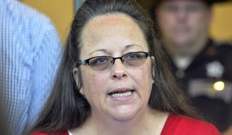 Rowan County Clerk Kim Davis spent five days in jail for disobeying a federal court order to issue licenses to gay couples. When she returned to work last week, she altered the license forms to say they were issued under the authority of the federal court instead of her office. (Associated Press)