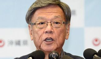 "Okinawa Gov. Takeshi Onaga speaks during a press conference at the prefectural government office in Naha in Okinawa, southern Japan, Monday, Sept. 14, 2015. Onaga said Monday he is preparing to revoke approval for work needed to relocate a U.S. military air base from one area of the southern Japanese island to another, just days after the work was restarted. ""We will take all possible measures to block base construction in Henoko, and this is the first step,"" Onaga told the news conference. (Hiroko Harima/Kyodo News via AP) JAPAN OUT, MANDATORY CREDIT"