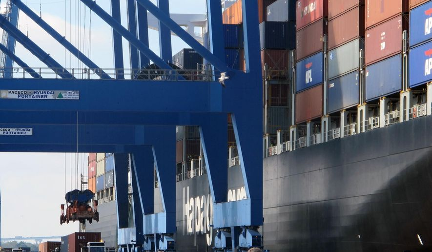 In this Feb. 18, 2015 photo, a container ship is unloaded at the Wando-Welch Terminal in Mount Pleasant, S.C. A report released on Monday, Sept. 14, 2015 finds that the South Carolina ports generate $53 billion annually for the state's economy. (AP Photo/Bruce Smith)