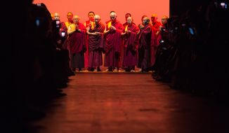 Buddhist monks perform before the Prabal Gurung Spring 2016 collection is modeled during Fashion Week Sunday Sept. 13, 2015, in New York. (AP Photo/Bryan R. Smith)