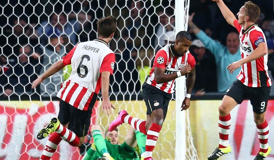 PSV's Luciano Narsingh, center, celebrates with his teammates PSV's Luuk de Jong, right, and PSV's Davy Proepper, left, scoring his sides second goal past Manchester United's goalkeeper David de Gea, right, during the Champions League Group B soccer match between PSV and Manchester United at Philips stadium in Eindhoven, Netherlands, Tuesday, Sept. 15, 2015. (AP Photo/Peter Dejong)
