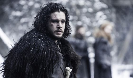 """In this image released by HBO, Kit Harington portrays Jon Snow in a scene from """"Game of Thrones."""" (Helen Sloan/HBO via AP)"""