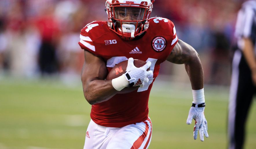 FILE - In this Saturday, Sept. 12, 2015, file photo, Nebraska running back Terrell Newby runs for a touchdown during the first half of an NCAA college football game against South Alabama in Lincoln, Neb.  If Miami quarterback Brad Kaaya helps the Hurricanes beat Nebraska this weekend, it would perhaps be doubly disappointing for the standout Cornhuskers running back. After all, Newby's father basically got Kaaya his start in football.  (AP Photo/Nati Harnik, File)