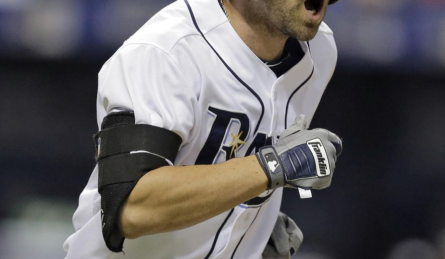 Tampa Bay Rays' Nick Franklin reacts as he watches his two-run home run off New York Yankees relief pitcher Nick Rumbelow during the sixth inning of a baseball game Tuesday, Sept. 15, 2015, in St. Petersburg, Fla.  (AP Photo/Chris O'Meara)