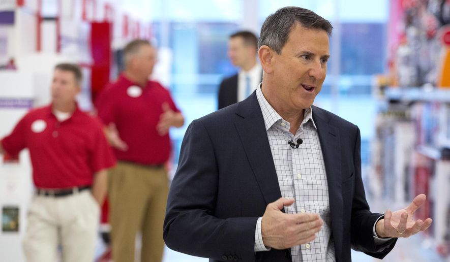 Target CEO Brian Cornell talks with a reporter at the CityTarget store in Boston on Aug. 21, 2015. (Associated Press) **FILE**