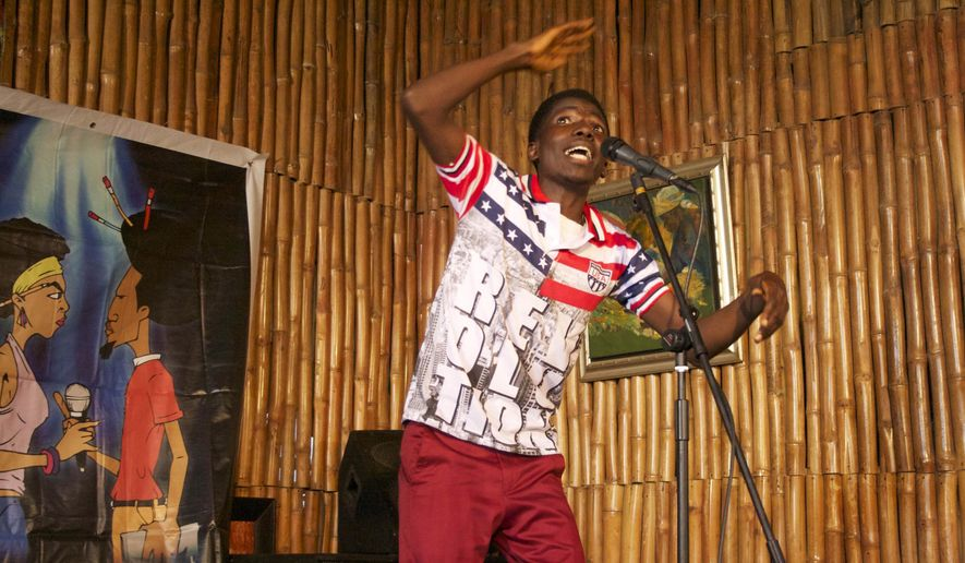"In this photo taken Sunday, Aug. 16, 2015, Bankole Kolawole competes in a slam poetry competition in Lagos, Nigeria. Nigeria's young poets hurled words against the injustices plaguing the giant of Africa, from corruption to Boko Haram's insurgency, in the fifth ""War of Words"" poetry slam. (AP Photo/Caelainn Hogan)"