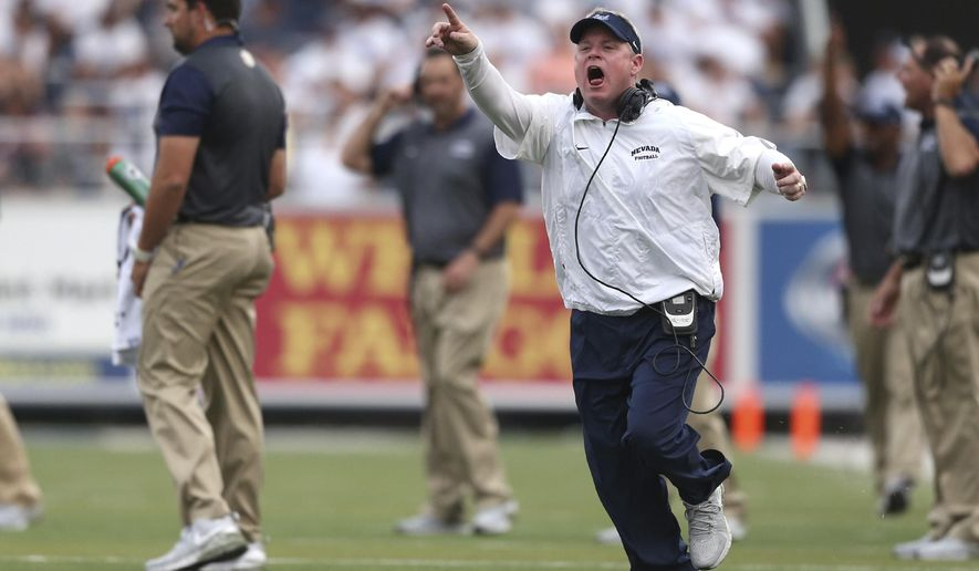 In this Saturday, Sept. 12, 2015, photo, Nevada coach Brian Polian yells to an official during an NCAA college football game against Arizona in Reno, Nev. The Mountain West Conference has fined Polian $10,000 after he twice was called for unsportsmanlike conduct penalties during Saturday's 44-20 loss to Arizona. (AP Photo/Cathleen Allison)
