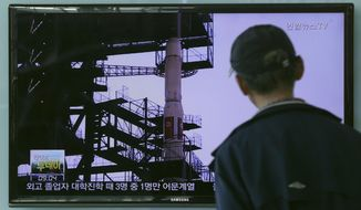 A South Korean man watches TV news program showing a file footage of the Unha rocket in North Korea, at Seoul Railway Station in Seoul, South Korea, Tuesday, Sept. 15, 2015. North Korea said Monday it is ready to launch satellites aboard long-range rockets to mark a key national anniversary next month, a move expected to rekindle animosities with its rivals South Korea and the United States. (AP Photo/ahn Young-joon)