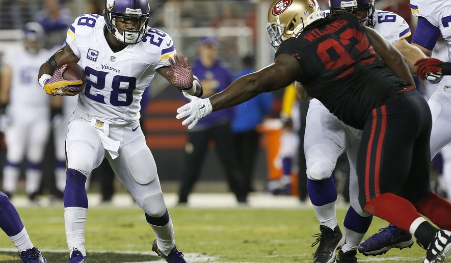 Minnesota Vikings running back Adrian Peterson (28) runs against San Francisco 49ers nose tackle Ian Williams (93) during the first half of an NFL football game in Santa Clara, Calif., Monday, Sept. 14, 2015. (AP Photo/Tony Avelar)