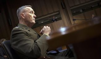 "Marine Corps Commandant Gen. Joseph Dunford, Jr., testifies during his Senate Armed Services Committee confirmation hearing to become the Chairman of the Joint Chiefs of Staff, on Capitol Hill in Washington, Thursday, July 9, 2015.  Dunford said Russia poses the greatest national security threat to the United States and that it would be ""reasonable"" to supply lethal arms to Ukrainians fighting against rebels backed by Moscow.  (AP Photo/Cliff Owen)"