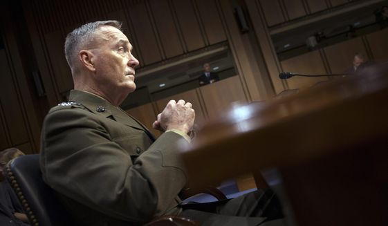 """Marine Corps Commandant Gen. Joseph Dunford, Jr., testifies during his Senate Armed Services Committee confirmation hearing to become the Chairman of the Joint Chiefs of Staff, on Capitol Hill in Washington, Thursday, July 9, 2015.  Dunford said Russia poses the greatest national security threat to the United States and that it would be """"reasonable"""" to supply lethal arms to Ukrainians fighting against rebels backed by Moscow.  (AP Photo/Cliff Owen)"""