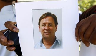 This image of Shannon Lamb, displayed in a digital photograph, was released by the Mississippi Department of Public Safety investigators to members of the media. Lamb, who killed himself, was considered a suspect in the shooting death of Delta State University history professor Ethan Schmidt, Monday, Sept. 14, 2015, at the Cleveland, Miss., campus. AP Photo/Rogelio V. Solis)