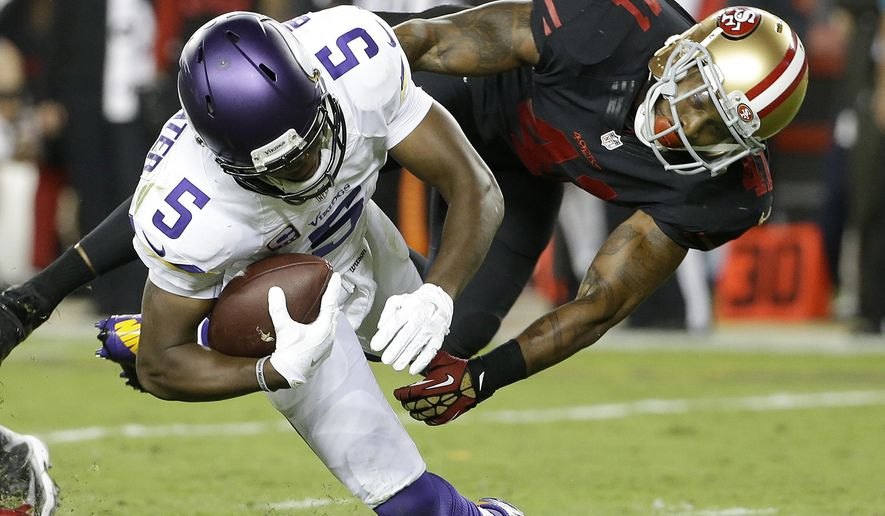San Francisco 49ers strong safety Antoine Bethea (41) sacks Minnesota Vikings quarterback Teddy Bridgewater (5) during the second half of an NFL football game in Santa Clara, Calif., Monday, Sept. 14, 2015. (AP Photo/Marcio Jose Sanchez)