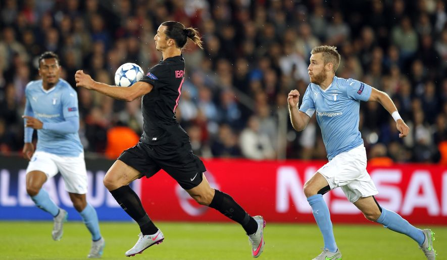 PSG's Zlatan Ibrahimovic, center, controls the ball during the Champions League Group A soccer match between PSG and Malmo at the Parc des Princes stadium in Paris, France, Tuesday, Sept. 15, 2015. (AP Photo/Francois Mori)