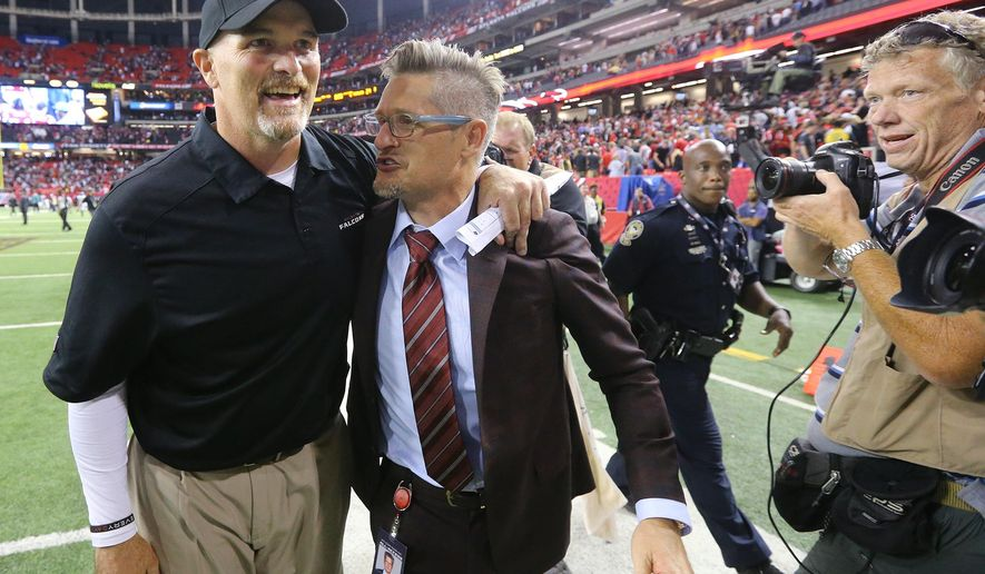 Falcons head coach Dan Quinn celebrates winning his first NFL game as a head coach with General Manager Thomas Dimitroff after an NFL football game on Monday, Sept. 14, 2015, in Atlanta. The Falcons won 26-24. (Curtis Compton/Atlanta-Journal Constitution via AP) MARIETTA DAILY OUT, GWINNETT DAILY POST OUT, LOCAL TV OUT (WXIA, WGCL, FOX 5)