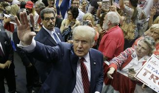 Republican presidential candidate Donald Trump waves to supporters after speaking at a campaign event in Dallas on Sept. 14, 2015. (Associated Press) **FILE**