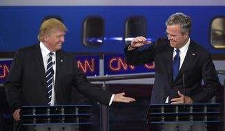 Then-Republican presidential candidate Donald Trump, left, and Jeb Bush slap hands near the finish of the CNN Republican presidential debate at the Ronald Reagan Presidential Library and Museum on Wednesday, Sept. 16, 2015, in Simi Valley, Calif. (AP Photo/Mark J. Terrill) ** FILE **