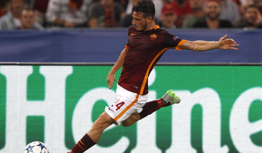 Roma's Alessandro Florenzi kicks the ball during a Champions League, Group E soccer match between Roma and Barcelona, at Rome's Olympic stadium Wednesday, Sept. 16, 2015. (AP Photo/Riccardo De Luca)