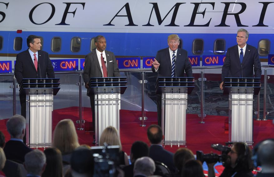 Republican presidential candidates Ted Cruz, left, Ben Carson, second from left, Donald Trump, second from right, and Jeb Bush appear during the CNN Republican presidential debate at the Ronald Reagan Presidential Library and Museum on Wednesday, Sept. 16, 2015, in Simi Valley, Calif. (AP Photo/Mark J. Terrill)