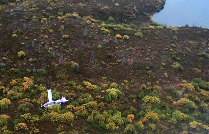 This Sept. 15, 2015 photo provided by Alaska State Troopers shows an aerial view of a small plane that crashed near a lake in rural southwest Alaska, killing three travelers from California and Pennsylvania and injuring seven others aboard, some critically. The De Havilland DHC-3 Turbine Otter was taking off for a fishing trip when it went down outside the tiny town of Iliamna, 175 miles southwest of Anchorage, National Transportation Safety Board Alaska Chief Clint Johnson said. (Alaska State Troopers via AP)