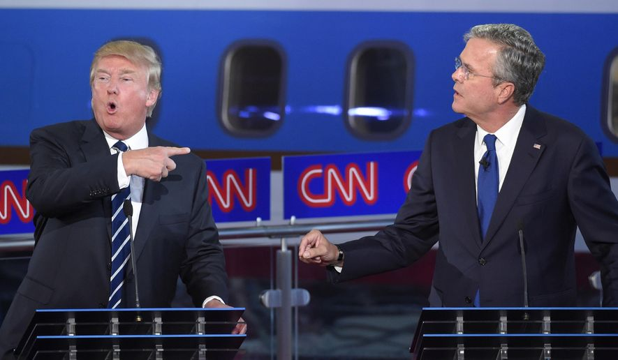 Republican presidential candidates, former Florida Gov. Jeb Bush, right, and Donald Trump both speak during the CNN Republican presidential debate at the Ronald Reagan Presidential Library and Museum on Wednesday, Sept. 16, 2015, in Simi Valley, Calif. (AP Photo/Mark J. Terrill)