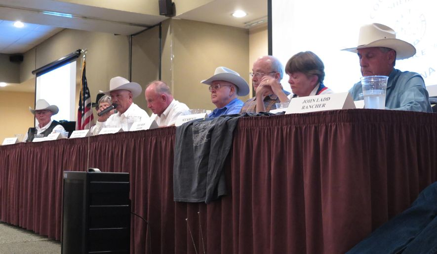 Rancher Ed Ashurst, third from left, criticizes the federal government over its enforcement of border safety during a meeting for border sheriffs in Sierra Vista, Ariz., on Wednesday, Sept. 16, 2015. Ashurts owns a ranch 20 miles north of the border with Mexico, east of Douglas, Ariz. Others are unidentified. (AP Photo/Astrid Galvan)