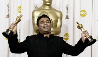 "In this Feb. 22, 2009 photo, A.R. Rahman holds the Oscars for best original score and for best original song ""Jai Ho"" for his work on ""Slumdog Millionaire"" during the 81st Academy Awards in the Hollywood section of Los Angeles. Indian music composer A.R. Rahman has said that he did not intend to offend anyone when he composed the music for an Iranian film on the Prophet Muhammad. Rahman was responding to a religious edict, or fatwa, by a Muslim organization against him and the Iranian director of the film. (AP Photo/Matt Sayles, file)"