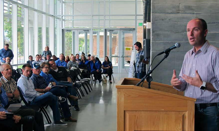 Utah Lt. Gov. Spencer Cox, right, speaks to lawmakers touring a new building at the Utah State University Eastern campus in Price, Utah, Wednesday, Sept. 16, 2015. (AP Photo/Michelle L. Price) ** FILE **