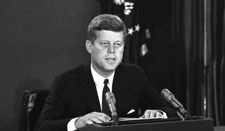 In this Oct. 22, 1962, photo, President John F. Kennedy makes a national television speech from Washington.  He announced a naval blockade of Cuba until Soviet missiles are removed. As the U.S. and Russia reached the brink of nuclear war in 1962, Kennedy received top-secret intelligence from the CIA that a new warhead launcher was spotted in Cuba. That report, given to Kennedy a day before the end of the Cuban Missile Crisis, is among roughly 19,000 pages of newly declassified CIA documents from the Cold War released Wednesday, Sept. 16, 2015. (AP Photo/File)