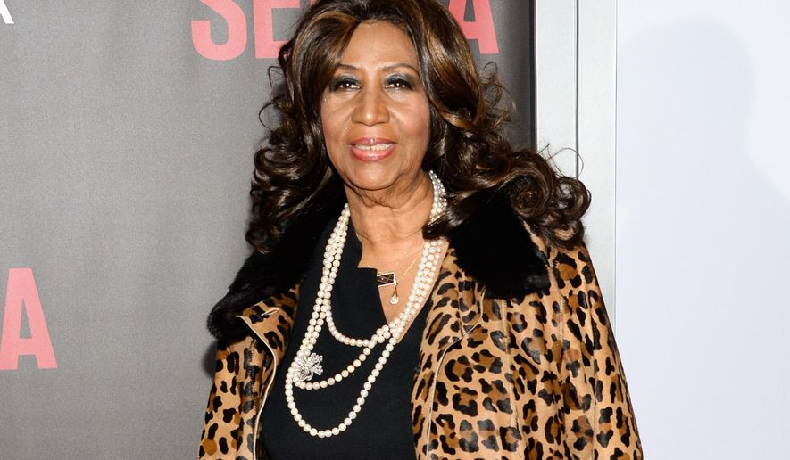 """FILE - In this Dec. 14, 2014 file photo, singer Aretha Franklin attends the premiere of """"Selma"""" in New York. The producer of the Aretha Franklin documentary """"Amazing Grace"""" has agreed not to show the film for the next month as he and the Queen of Soul try to resolve their dispute over the work. Earlier this month, a Denver federal judge halted a screening of the film about a 1972 Franklin concert just hours before it was to be shown at the Telluride Film Festival. Producer Alan Elliott then withdrew it from the Toronto Film Festival but Franklin claims he held a screening for the festival's exhibitors and film distributors Saturday. (Photo by Evan Agostini/Invision/AP, File)"""