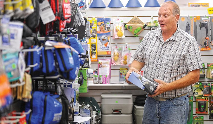 ADVANCED FOR RELEASE SUNDAY, SEPTEMBER 20, 2015 Rusty Kappel, owner of The Preparedness Store, talks Friday about some of the different varieties of water filters that he sells in Idaho Falls. Kappel carries 25 different types of water filters, which are some of his best-selling products. (Pat Sutphin/Post Register via AP)