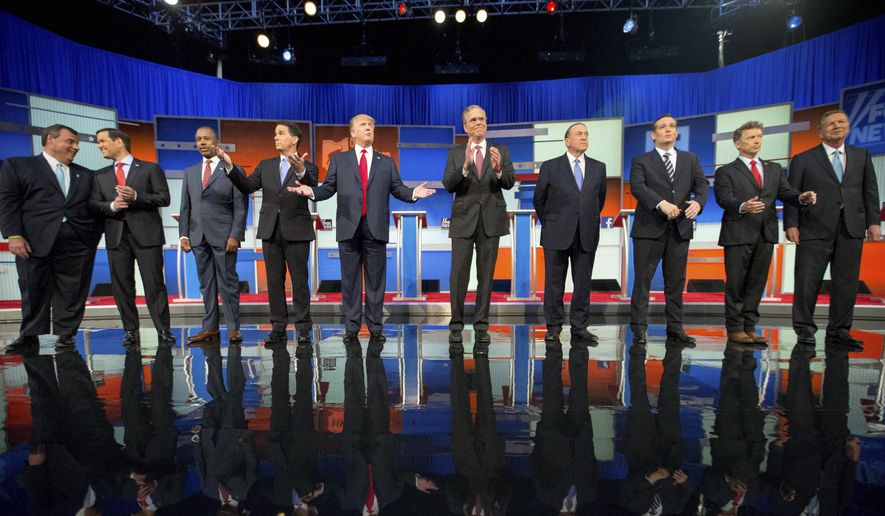 In this Aug. 6, 2015, file photo, Republican presidential candidates from left, Chris Christie, Marco Rubio, Ben Carson, Scott Walker, Donald Trump, Jeb Bush, Mike Huckabee, Ted Cruz, Rand Paul, and John Kasich take the stage for the first Republican presidential debate in Cleveland. (AP Photo/Andrew Harnik, File)
