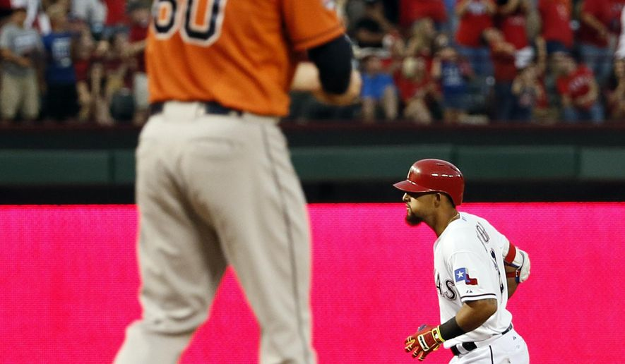 Houston Astros' Dallas Keuchel walks back onto the mound as Texas Rangers' Rougned Odor rounds the bases on a two-run home run during the first inning of a baseball game Wednesday, Sept. 16, 2015, in Arlington, Texas. (AP Photo/Tony Gutierrez)
