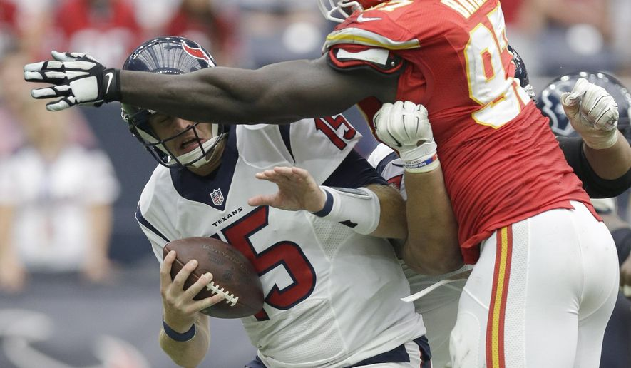 Houston Texans' Ryan Mallett (15) is pressured by Kansas City Chiefs' Allen Bailey (97) during the second half of an NFL football game Sunday, Sept. 13, 2015, in Houston. (AP Photo/Patric Schneider)